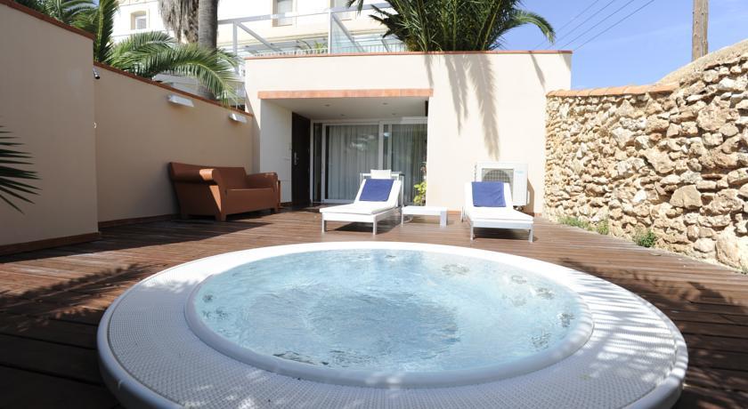 Tu escapada deluxe hoteles con habitaciones con jacuzzi for Jacuzzi exterior terraza